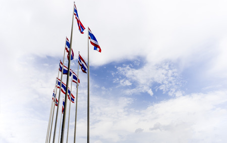 waft: Raw of waving Thai flag of Thailand with blue sky background