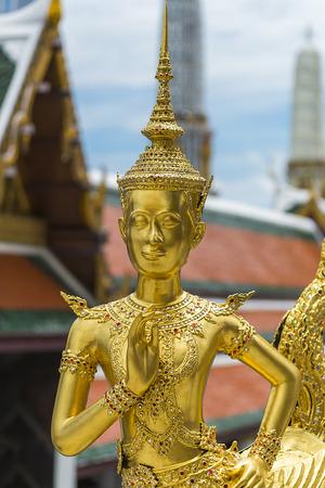 golden orb weaver: A Golden Kinnari statue at the Temple of the Emerald Buddha (Wat Phra Kaew) , Bangkok, Thailand Stock Photo