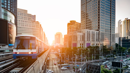 Bangkok cityscape in the morning with BTS Sky train is approaching at the station Standard-Bild