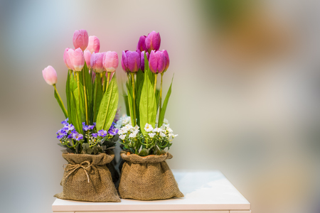 Artificial Flowers decoration on blurred background Stock Photo