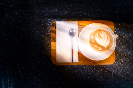 Top view of Coffee cup on the black Marble table in the morning