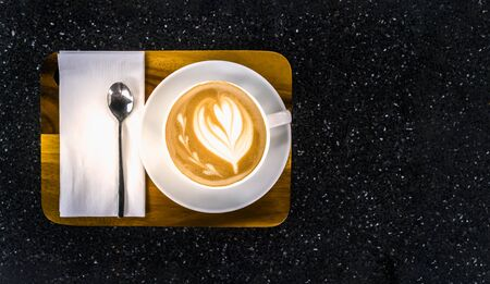 Top view of Coffee cup on the black Marble table Stock Photo