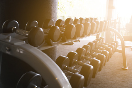 Raw of dumbbell in sport club at the morning Stock Photo
