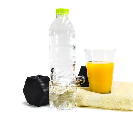 Dumbells, drinking water and orange juice concept for  Fitness and health. Isolated on white background