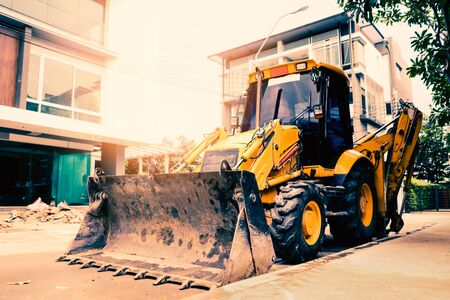 Yellow buldozer parking in the construction site at the morning : prepare for hard working Banque d'images