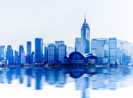 Hong Kong cityscape with water reflections at victoria harbor