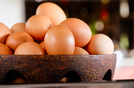 Eggs in a wood basket ,selective focus Stock fotó