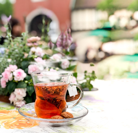 English style afternoon hot herbal tea with cookies at the backyard garden