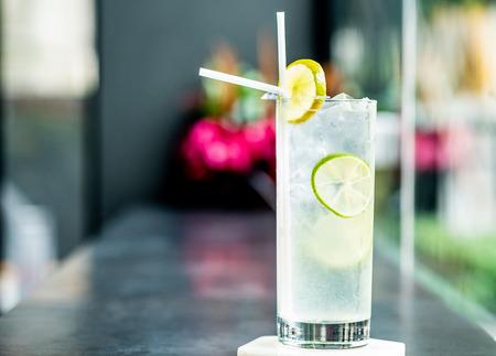 Sparkling lemon soda juice in glass served in restaurant