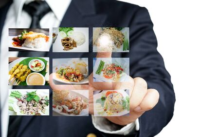 Businessman hand making selection of food menu with digital touch screen Standard-Bild - 126962908