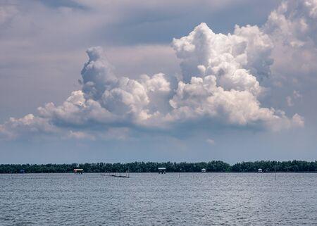Landscape view of coastal village under cloudy sky in Thailand Standard-Bild - 126963072