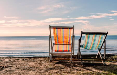 Tranquil scene of beautiful beach at the morning with two beach chairs Standard-Bild - 130674539