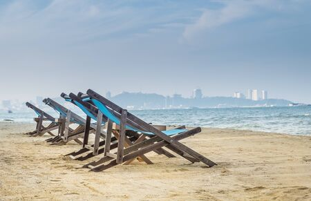 Beach chairs on Pattaya beach, thailand Standard-Bild - 130673960