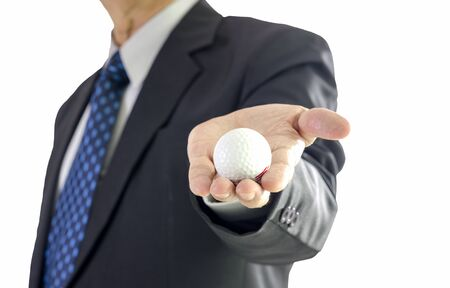 Hand holding golf ball, Isolated on white background