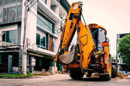 Yellow Bulldozer prepare for road repair in housing Estate