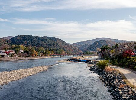 Uji-Gawa river and red bridge in autumn , Kyoto, Japan Standard-Bild - 131291846