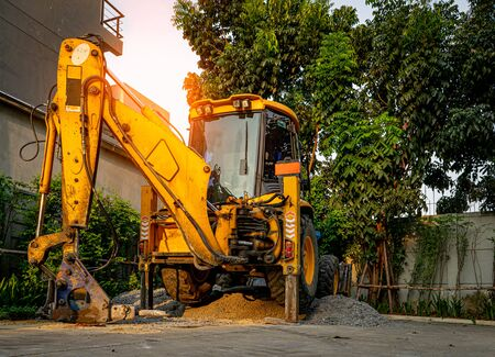 Yellow Bulldozer prepare for road repair in housing Estate