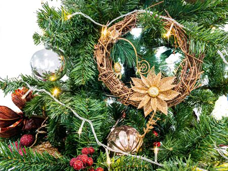 Christmas decoration composed of fresh fir branches and sparkling decor with shines lights. Stock Photo