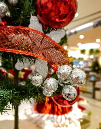 Christmas decoration with artificial pine tree and silver ball