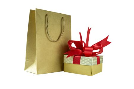 Shopping bag and gift box with red ribbon , Isolated on white background