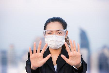 Portrait of an Asian woman wearing a black oil mask, anti-virus. Feeling stressed