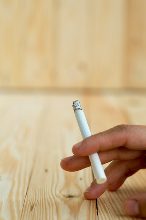 ignited: Cigarettes are ignited in The wooden floor Stock Photo