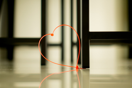 cable tie: Cable Tie pink heart-shaped  color in dim light .