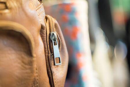 zipper: Brown zipper bag at night