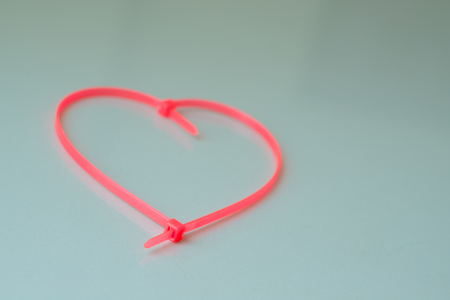 zip tie: Cable Tie pink heart-shaped  color in dim light .