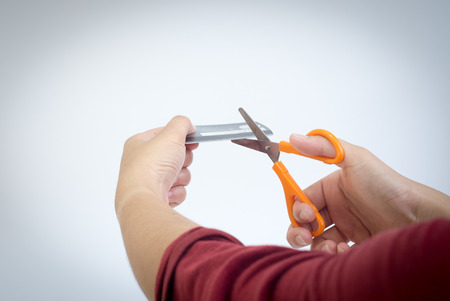 Destroy credit card Using scissors.tHE cONCEPT With the idea that Stop wasteful spending
