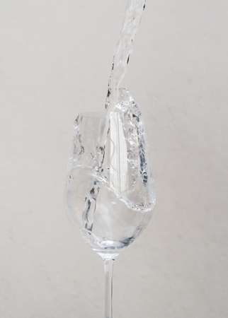 pour water: Pour water into a glass of wine