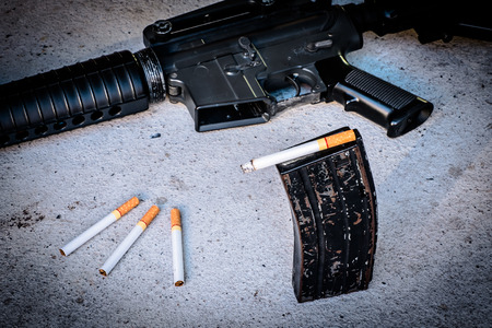 kill: cigarette in Magazine gun.Customizable dark tones.Indicate smoking kill you like a gunshot. Stock Photo