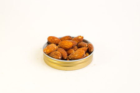 the kernel: Salted almonds On a white background Stock Photo