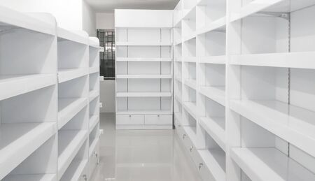 cabinets: Soft focus , white shelves .