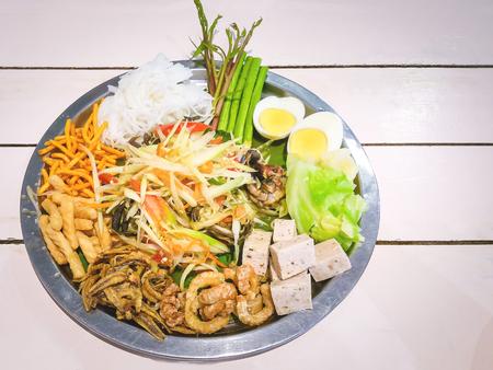 The most delicious papaya salad tray.Popular menu in Thailand. somtum Stock Photo