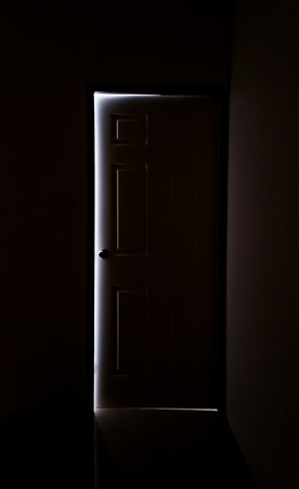 room door: The light from the door in a dark room