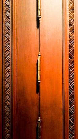brass door hinges on a Antique wooden doors.