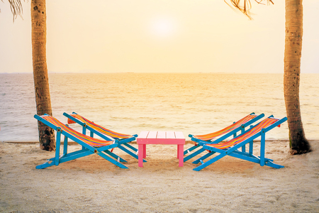 Beautiful relax Beach terrace with armchairs and Table on tha sea coast At the time of sunset . Table and chairs by the sea in BangSaen thailand . Stock Photo