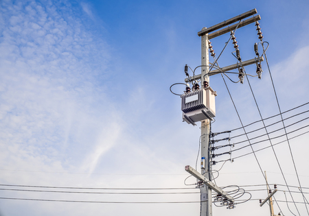 electric grid: Transformers, power electric pole On the bright sky. The equipment used to raise or lower voltage, high Stock Photo
