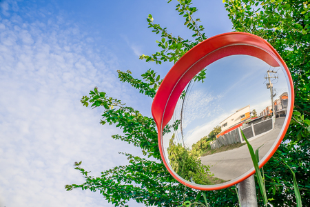 ruzomberok: Reflection of road in the traffic safety mirror.