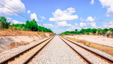 Landscape railroad tracks or railway in Thailand During the daytime and bright sky .