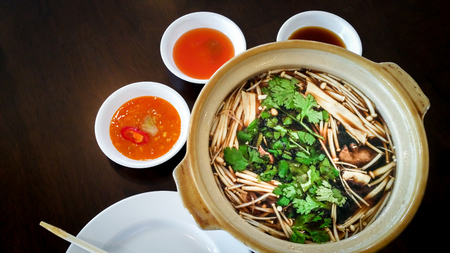 Bak Kut Teh in terracotta bowl . (Malaysia & Singapore Local Food)