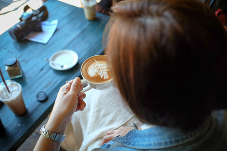 Happy business young woman taking selfie with Smart Phone Enjoyment with Cappuccino coffee and relax In her holiday .