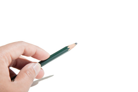 Hand holding a pencil preparing to draw or write isolate