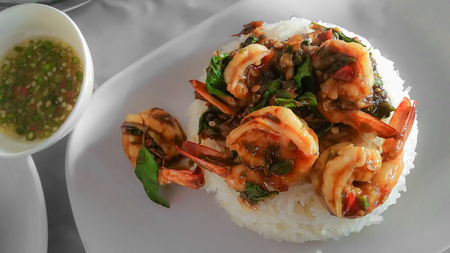 Stir-fried Basil with shrimp and seafood hot and spicy sauce with basil leaf on top rice, popular traditional and Recommended MenuThai food.