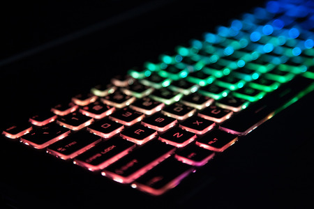 Closeup of keyboard illumination Multicolour Rainbow colors for play Games Online. backlit keyboard Concept
