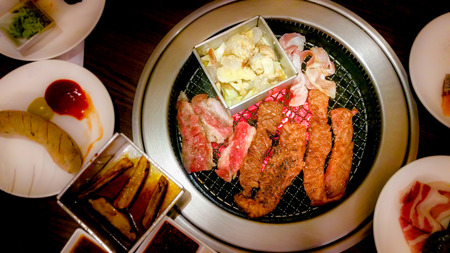 Meat grilled on charcoal stove and marinated pork ,beef slices with ingredients for cooking grilled BBQ Korean and Japanese food , Recommended dishes in Asian cuisine .