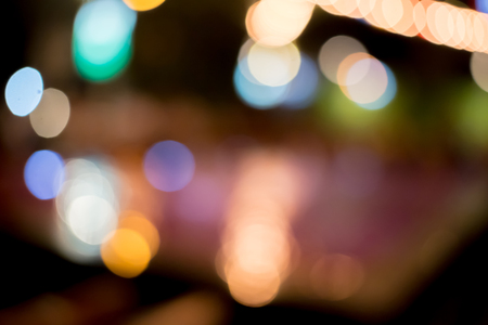 Background Abstract bokeh glitter colorful of light Moving look at the festive decorations Merry Christmas and New Year in holidays night city street  .