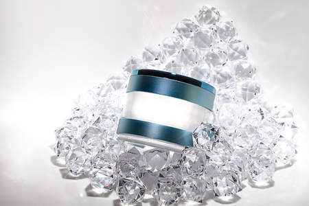 Elegant cosmetic jars product ads, skin care and beauty Moisturizing cream Luxury bright fresh on the diamonds background with light effect . A space for add logo and copy space .