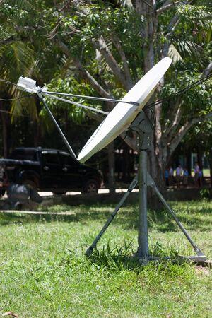 aisa: Satellite dish in rural area. Stock Photo